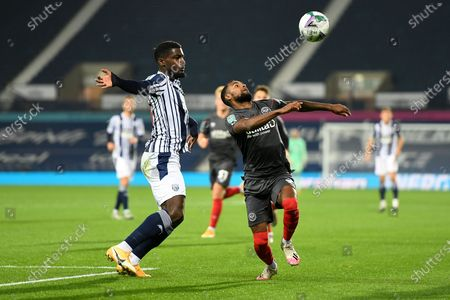 Brentford FC defender Rico Henry (3) battles for possession  with West Bromwich Albion defender Cedric Kipre (24) during the EFL Cup match between West Bromwich Albion and Brentford at The Hawthorns, West Bromwich