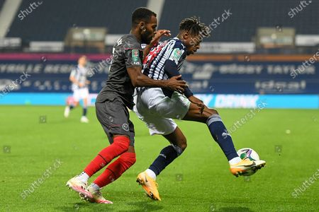 Brentford FC defender Rico Henry (3) battles for possession  with West Bromwich Albion striker Kyle Edwards (21) during the EFL Cup match between West Bromwich Albion and Brentford at The Hawthorns, West Bromwich