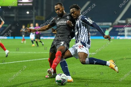 West Bromwich Albion striker Kyle Edwards (21) battles for possession  with Brentford FC defender Rico Henry (3) during the EFL Cup match between West Bromwich Albion and Brentford at The Hawthorns, West Bromwich