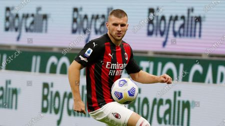 Milan's Ante Rebic controls the ball during the Serie A soccer match between AC Milan and Bologna at the San Siro stadium, in Milan, Italy