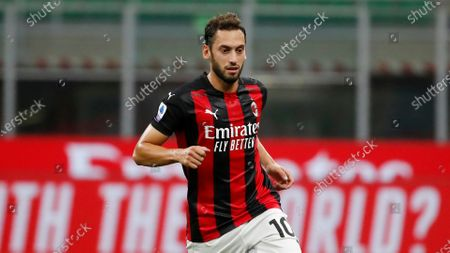 Milan's Hakan Calhanoglu controls the ball during the Serie A soccer match between AC Milan and Bologna at the San Siro stadium, in Milan, Italy