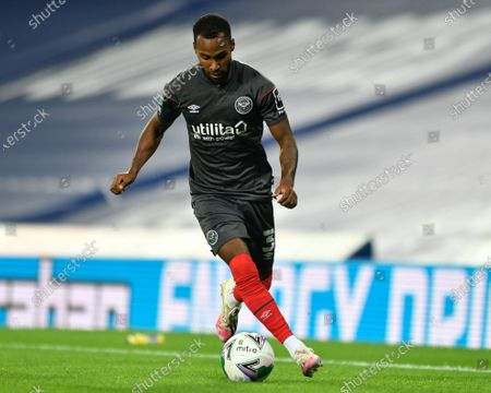 Rico Henry (3) of Brentford controls the ball on the wing