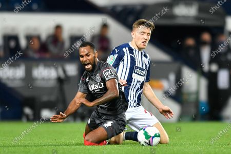 Dara O'Shea (27) of West Bromwich Albion fouls Rico Henry (3) of Brentford on the edge of the penalty box