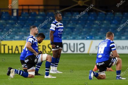 Semesa Rokoduguni of Bath Rugby stands to attention as the rest of his team-mates take a knee prior to the match