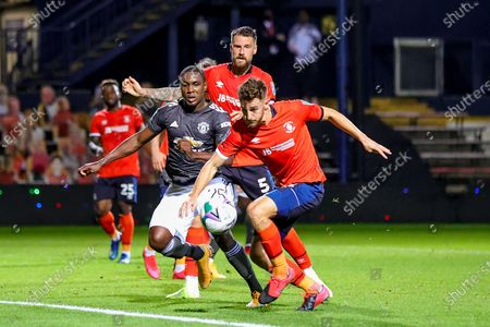 Luton Town defender Tom Lockyer (15) clears the ball from Manchester United forward Odion Ighalo (25) during the EFL Cup match between Luton Town and Manchester United at Kenilworth Road, Luton