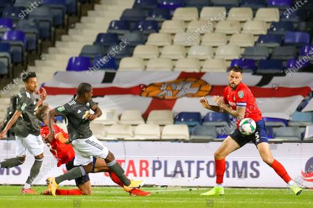 Manchester United forward Odion Ighalo (25) shoots towards the goal during the EFL Cup match between Luton Town and Manchester United at Kenilworth Road, Luton