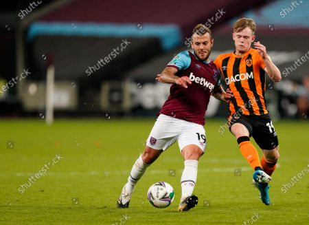 Stock Image of West Ham's Jack Wilshere, left, duels for the ball with Hull City's Keane Lewis-Potter during the English League Cup soccer match between West Ham and Hull City at the London Stadium in London