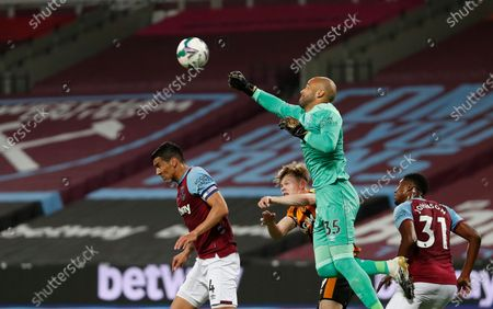 West Ham's goalkeeper Darren Randolph, top, makes a save in front of Hull City's Keane Lewis-Potter during the English League Cup soccer match between West Ham and Hull City at the London Stadium in London