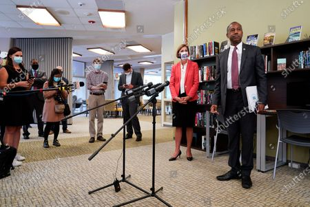 Housing and Urban Development Secretary Ben Carson and Iowa Gov. Kim Reynolds speak to reporters after touring the Plymouth Place senior housing facility, in Des Moines, Iowa