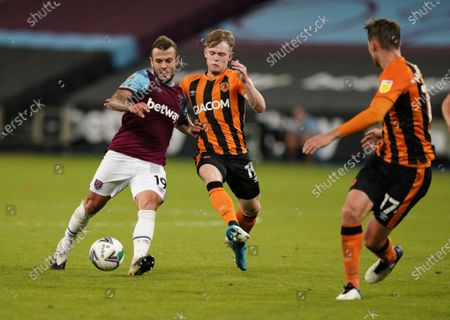 Jack Wilshere of West Ham (L) in action against Keane Lewis-Potter of Hull (C) during the English Carabao Cup third round match between West Ham United and Hull City in London, Britain, 22 September 2020.