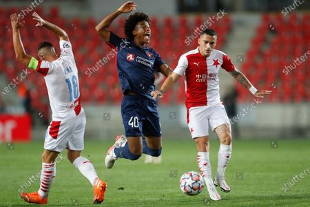 Slavia's Nicolae Stanciu, right, and Slavia's Jan Boril, left, challenge Midtjylland's Jens-Lys Cajuste, center, during their first leg UEFA Champions League play off soccer match between Slavia Praha and FC Midtjylland at the Sinobo stadium in Prague, Czech Republic