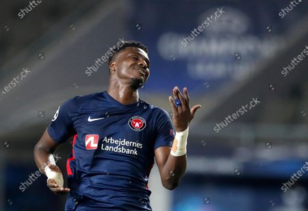 Midtjylland's Sony Kaba reacts after missing a chance during the first leg UEFA Champions League play off soccer match between Slavia Praha and FC Midtjylland at the Sinobo stadium in Prague, Czech Republic