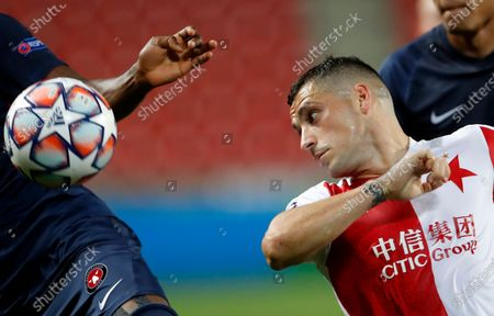 Slavia's Nicolae Stanciu eyes the ball during the first leg UEFA Champions League play off soccer match between Slavia Praha and FC Midtjylland at the Sinobo stadium in Prague, Czech Republic