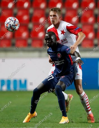 Slavia's David Zima, right, challenges Midtjylland's Awer Mabil during their first leg UEFA Champions League play off soccer match between Slavia Praha and FC Midtjylland at the Sinobo stadium in Prague, Czech Republic