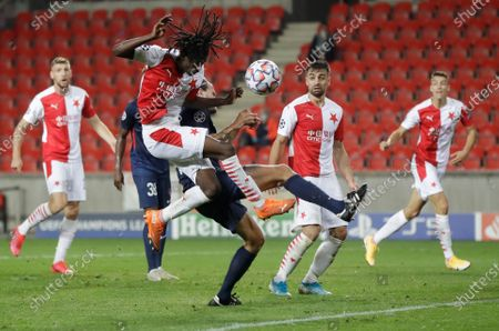 Slavia's Peter Olayinka tries to score during the first leg UEFA Champions League play off soccer match between Slavia Praha and FC Midtjylland at the Sinobo stadium in Prague, Czech Republic