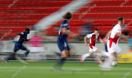 Slavia's Lukas Masopust controls the ball during the first leg UEFA Champions League play off soccer match between Slavia Praha and FC Midtjylland at the Sinobo stadium in Prague, Czech Republic