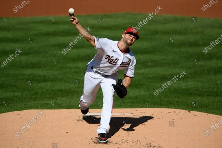 Washington Nationals starting pitcher Austin Voth delivers a pitch during the first inning of the first baseball game of a doubleheader against the Philadelphia Phillies, in Washington
