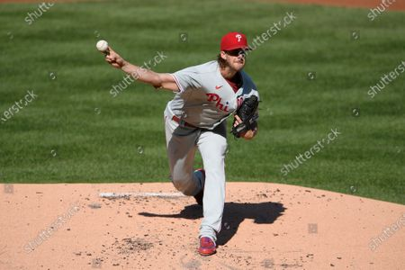 Philadelphia Phillies starting pitcher Aaron Nola delivers a pitch during the first inning of the first baseball game of a doubleheader against the Washington Nationals, in Washington