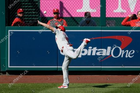 Stock Image of Philadelphia Phillies left fielder Mickey Moniak cannot get a ball hit by Washington Nationals' Juan Soto during the first inning of the first baseball game of a doubleheader, in Washington. Moniak was charged with a fielding error on the play and Soto went to second base