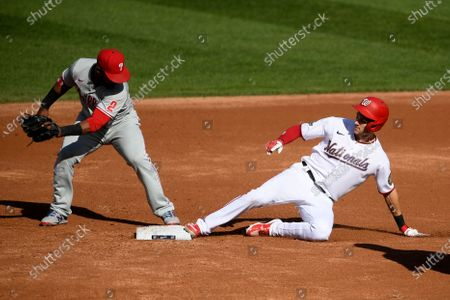 Stock Photo of Washington Nationals' Trea Turner, right, slides into second ahead of the tag by Philadelphia Phillies second baseman Jean Segura, left, for a double during the third inning of the first game of a baseball doubleheader, in Washington