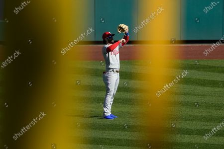Framed by the left field foul pole, Philadelphia Phillies right fielder Bryce Harper stands on the field during the second inning of the first baseball game of a doubleheader, in Washington