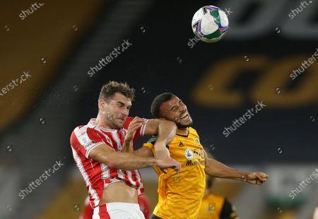 Stoke City's Sam Vokes battles with Wolverhampton Wanderers Romain Saiss