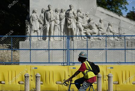 Cyclist passes the Alamo Cenotaph, in San Antonio. The Texas Historical Commission is set to decide whether to allow the restoration and relocation of the Cenotaph, a 1930s-era stone monument to Texas revolutionaries killed in the Battle of the Alamo, as part of an effort to reclaim the historical footprint of the Alamo as part of a redevelopment plan