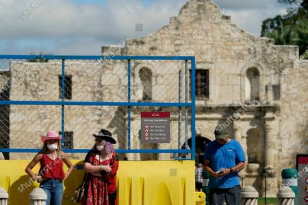 Visitors leave the recently reopened Alamo, in San Antonio. The Texas Historical Commission is set to decide whether to allow the restoration and relocation of the Cenotaph, a 1930s-era stone monument to Texas revolutionaries killed in the Battle of the Alamo, as part of an effort to reclaim the historical footprint of the Alamo as part of a redevelopment plan