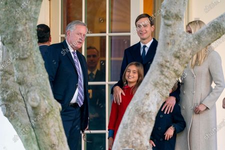 White House chief of staff Mark Meadows talks with White House adviser Jared Kushner, his wife Ivanka Trump their daughter Arabella Kushner, and their son Joseph as they watch from the Rose Garden as President Donald Trump speaks to members of the media on the South Lawn of the White House in Washington, before boarding Marine One for a short trip to Andrews Air Force Base, Md., and then onto Pittsburgh for a rally