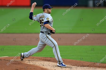 Milwaukee Brewers' Brett Anderson throws in the first inning during a baseball game against the Cincinnati Reds in Cincinnati