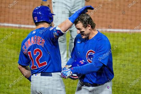 Stock Photo of Chicago Cubs' Anthony Rizzo, right, celebrates with Kyle Schwarber (12) as he returns to the dugout after hitting a two run home run off Pittsburgh Pirates relief pitcher Sam Howard during the eighth inning of a baseball game in Pittsburgh