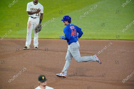 Chicago Cubs' Anthony Rizzo (44) rounds the bases after hitting a two run home run off Pittsburgh Pirates relief pitcher Sam Howard, bottom, during the eighth inning of a baseball game in Pittsburgh