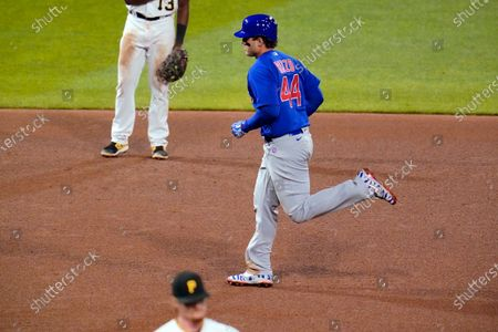 Stock Picture of Chicago Cubs' Anthony Rizzo (44) runs the bases after hitting a two-run home run off Pittsburgh Pirates relief pitcher Sam Howard, bottom, during the eighth inning of a baseball game in Pittsburgh