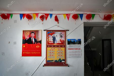 Posters showing images of Chinese President Xi Jinping and his wife Peng Liyuan are displayed on a wall of a home of members of the Yi minority group in Xujiashan village in Ganluo County, southwest China's Sichuan province on . Communist Party Xi's smiling visage looks down from the walls of virtually every home inhabited by members of the Yi minority group in a remote corner of China's Sichuan province. Xi has replaced former leader Mao Zedong for pride of place in new brick and concrete homes built to replace crumbling traditional structures in Sichuan's Liangshan Yi Autonomous Prefecture, which his home to about 2 million members of the group