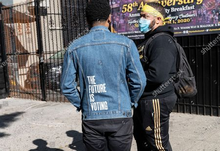 Ramon Contreras (on the left) wearing denim jacket by Levi's with wording The Future is Voting attends voter registration ahead of November election at Sylvia's Restaurant in Harlem. Registtration was organized by Young Black women protest group Freedom March NYC. It was coincident with National Voter Registration Day