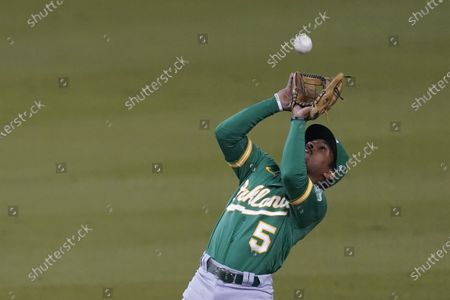 Oakland Athletics second baseman Tony Kemp catches a popup by Los Angeles Dodgers' Mookie Betts during the fourth inning of a baseball game, in Los Angeles