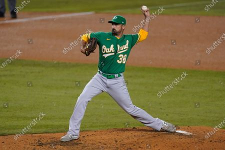 Oakland Athletics relief pitcher T.J. McFarland throws during the fifth inning of the team's baseball game against the Los Angeles Dodgers, in Los Angeles