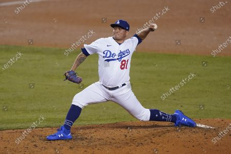 Los Angeles Dodgers relief pitcher Victor Gonzalez throws during the sixth inning of the team's baseball game against the Oakland Athletics, in Los Angeles