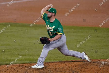 Oakland Athletics relief pitcher J.B. Wendelken throws during the seventh inning of the team's baseball game against the Los Angeles Dodgers, in Los Angeles