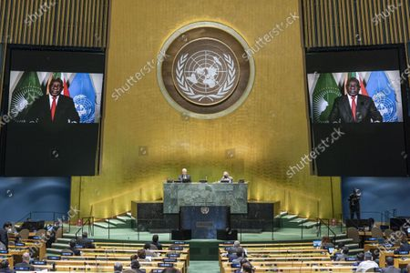 """South African President Cyril Ramaphosa (on the screens) addresses the general debate of the 75th session of the UN General Assembly at the UN headquarters in New York, on Sept. 22, 2020. The General Debate of the 75th session of the UN General Assembly opened on Tuesday with the theme of """"The future we want, the United Nations we need: reaffirming our collective commitment to multilateralism -- confronting COVID-19 through effective multilateral action."""""""