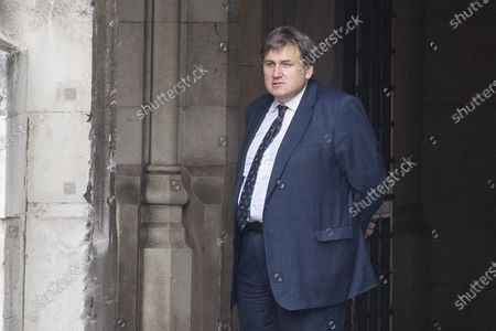 Minister of state for Crime, Policing and the Fire Service Kit Malthouse walks in The Houses of Parliament.