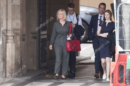 Secretary of State for International Trade Liz Truss (l) walks in The Houses of Parliament.