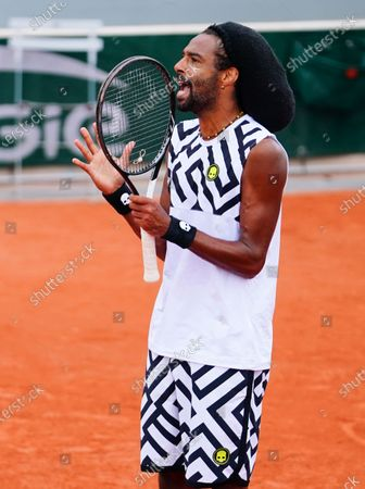 Dustin Brown of Germany reacts during his 2nd round qualifying win