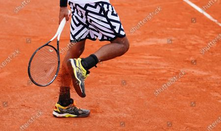Dustin Brown of Germanyhits clay of his shoes during his 2nd round qualifying win