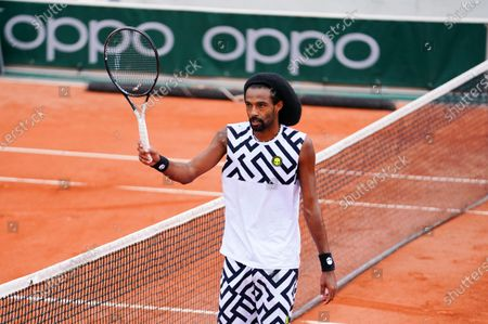 Dustin Brown of Germany celebrates his 2nd round qualifying win
