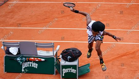Stock Photo of Dustin Brown of Germany narrowly avoids hitting his seat after sliding during his 2nd round qualifying win