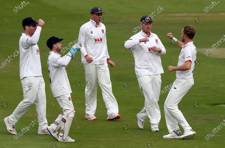 Stock Image of Sam Cook (right)of Essex is congratulated by Tom Westley, Daniel Lawrence, Simon Harmer, and Adam Wheater during Somerset CCC vs Essex CCC, Bob Willis Trophy Final Cricket at Lord's Cricket Ground on 23rd September 2020