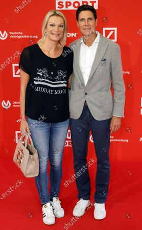 Retired German alpine skiier Maria Hoefl-Riesch (L) and her husband Marcus Hoefl (R) pose on the red carpet during 'Bild100 Sport' in Frankfurt am Main, Germany, 23 September 2020. The event invites 100 of the most important and influential German and international personalities of politics, economics and sport.
