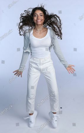"""Nour Ardakani, a teenage singer from Lebanon, poses for a photoshoot in Dubai, United Arab Emirates, . Ardakani became the latest to join a global pop band formed by Simon Fuller, the man behind the Spice Girls and """"American Idol,"""" which aims to transform young unknowns into internet superstars"""
