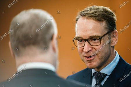 President of the Central Bank of Germany Jens Weidmann (R) and economy and finance policy advisor of the German Chancellor Lars-Hendrik Roeller talk